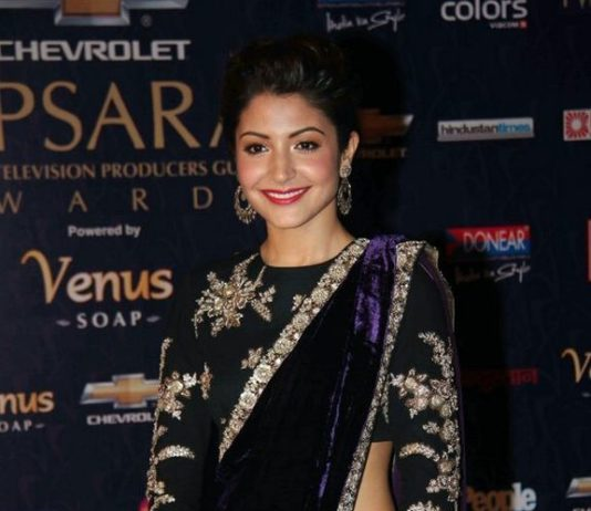 Anushka sharma wearing Saree