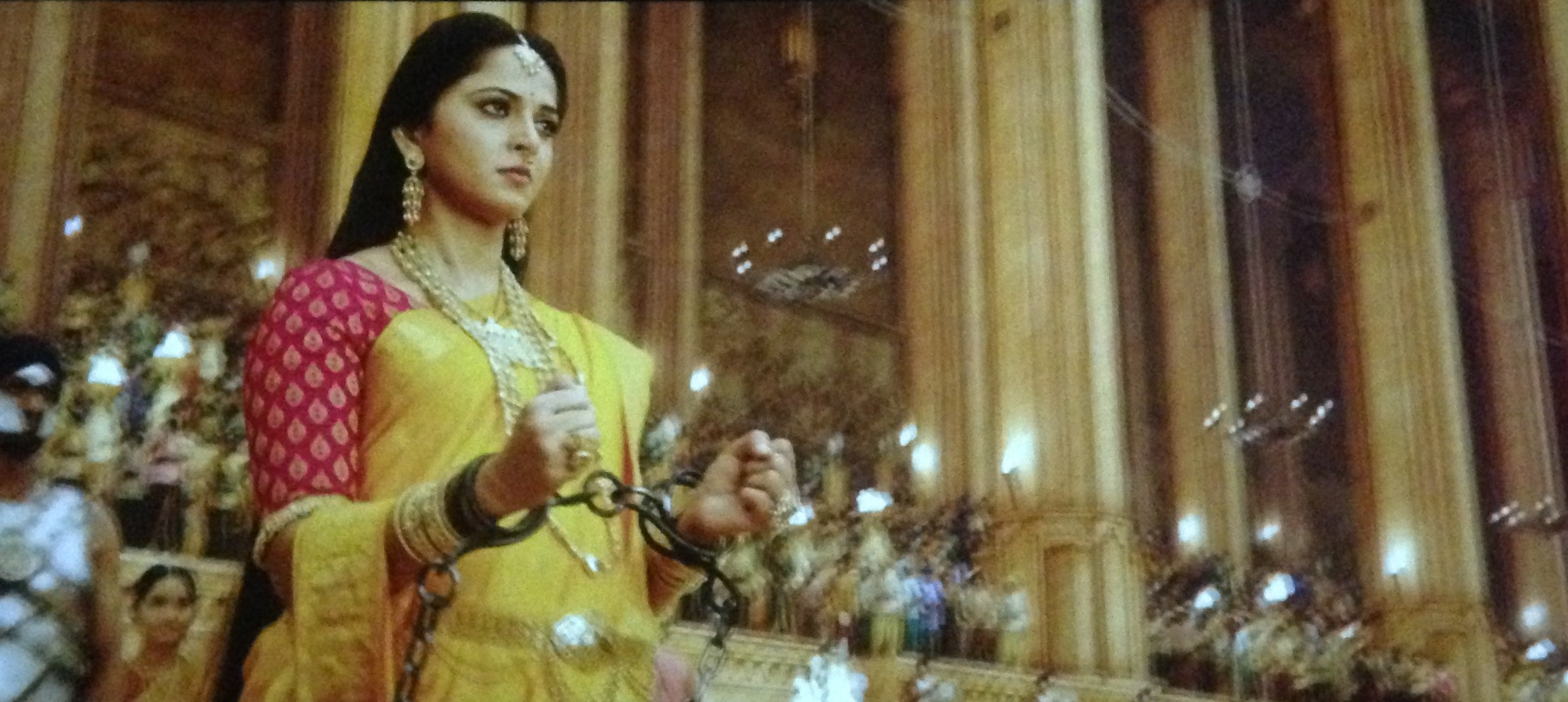 Anushka Shetty yellow saree in bahubali 2 The conclusion, Anushka Shetty handcuffed scene in bahubali 2