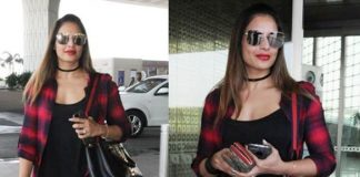 Bipasha basu, airport look, celebrities. longline shorts, black jeggings, white sports shoes, choker, red check shirt